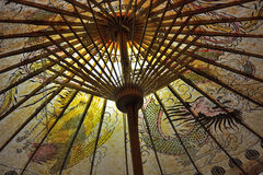 Beautiful paper umbrella. Beautiful chinese paper umbrella decorated with traditional drawings Stock Image