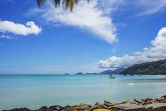 Beautiful paradise beach,white sand,turquoise water,palms, seych. Beautiful paradise beach anse bazarca on mahé. white sand,turquoise water,palm trees, granite Royalty Free Stock Photo