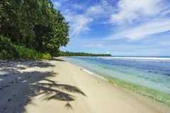Beautiful paradise beach,white sand,turquoise water,palms, seych. Beautiful paradise beach anse bazarca on mahé. white sand,turquoise water,palm trees, granite Stock Photo