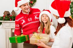 Parents giving presents to daughter Stock Image