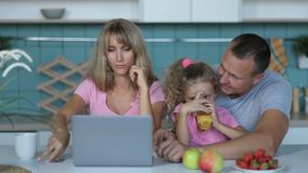 Joyful family shopping online with laptop at home stock video footage
