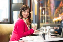 Beautiful Parisian girl drinking coffee Royalty Free Stock Photography
