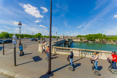 Beautiful parisian scene with Seine river with tourists Stock Photos