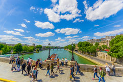 Beautiful parisian scene with Seine river with walking tourists Stock Photos