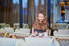 Beautiful Parisian woman in cafe stock photo