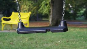 Beautiful park with the children's swing in Scotland, footage. Park with the children's swing in Scotland, footage stock footage