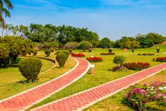 Beautiful park garden. With flower and footpath in sunny day stock photos