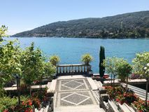Isola Bella Gardens with Trees and Flowers and Lake View. Beautiful park on the island of Isola Bella in Lago Maggiore, Italy,Lombardy ,Northern Italy royalty free stock photo