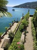 Isola Bella Gardens with Trees and Flowers and Lake View. Beautiful park on the island of Isola Bella in Lago Maggiore, Italy,Lombardy ,Northern Italy royalty free stock images