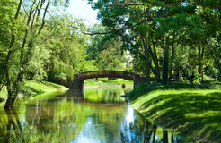 Beautiful park landscape with river and bridge Royalty Free Stock Photos