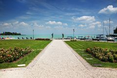 The beautiful park of roses and Balaton Lake seen from Balatonfured shore. Stock Photo