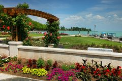 The beautiful park of roses and Balaton Lake seen from Balatonfured shore. Lake Balaton  is a freshwater lake in Transdanubian region of Hungary. It is the Stock Photography