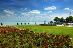 The beautiful park of roses and Balaton Lake seen from Balatonfured shore. Lake Balaton  is a freshwater lake in Transdanubian region of Hungary. It is the Stock Photo