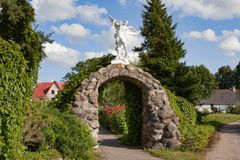 Beautiful park with sculptures near St. Anne`s Church in Mosar, Belarus, the site of the Jesuit. Mosar, Belarus - August 17, 2018: Beautiful park wih sculptures royalty free stock photography