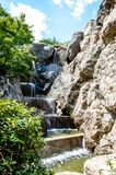 Small waterfall in the park royalty free stock image
