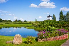 Beautiful park with sculptures near St. Anne`s Church in Mosar, Belarus, the site of the Jesuit. Beautiful park wih pond near St. Anne`s Church in Mosar, Belarus stock photos
