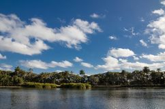 Beautiful parklands with lake and clouds with blue sky in the background, Sydney, Australia. A Beautiful parklands with lake and clouds with blue sky in the stock photography