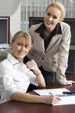 Beautiful partnership. Two blond women at the working table in the office Stock Photo