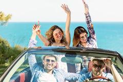 Beautiful party friend girls dancing in a car on the beach happy Royalty Free Stock Photography