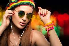 Beautiful Party Girl Enjoying Music Through Headphone Royalty Free Stock Image