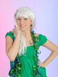Beautiful party woman in carnival mask and wig. Celebrating Royalty Free Stock Image