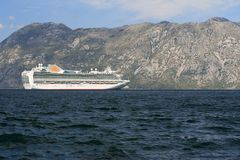 Beautiful passenger ship in the Bay of Kotor. Montenegro . Beautiful white passenger ship Venture in the Bay of Kotor. September 26th, 2014 Montenegro stock photos