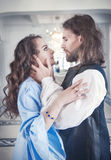 Beautiful passionate couple woman and man in medieval clothes. Beautiful passionate couple women and men in medieval clothes in the room Royalty Free Stock Image