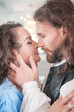 Beautiful passionate couple woman and man. Beautiful passionate couple women and men in medieval clothes royalty free stock photography