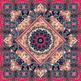 Beautiful patchwork carpet or festive tablecloth. Bright colorful illustration with floral ornament and mandala Stock Images