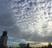 Beautiful patchy clouds over Newcastle civic centre. Winter sky over Newcastle upon Tyne city Stock Photo