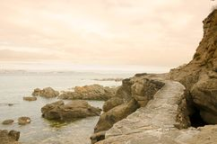 Paved path through the rocks. Beautiful path through the rocks leading to the Atlantic Ocean stock images