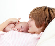 Beautiful patient with newborn baby in bed Stock Photo