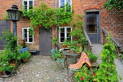 Beautiful patio of old house with flowers, royal town Ribe, Denmark stock images