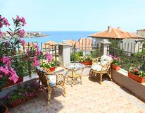 Beautiful patio surrounded by flowers royalty free stock photography