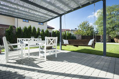 Beautiful patio with swing. In the garden Stock Images
