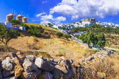Traditional Greece - Patmos island. View of old windmills and monastrey stock image