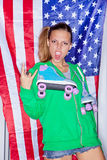 Beautiful patriotic girl. Beautiful girl with a roller skates in front of a flag of the U. S Royalty Free Stock Photo