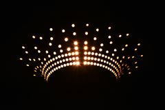 Light dots pattern. Beautiful pattern of dots of light in dark stock image