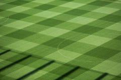Beautiful pattern of fresh green grass for football sport, football field, soccer field, team sport texture.  Royalty Free Stock Images
