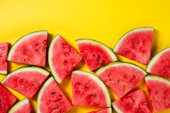 Beautiful pattern with fresh watermelon slices on yellow bright