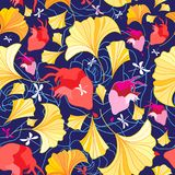Beautiful pattern of ginkgo leaves and hearts. On a dark blue background Stock Photography
