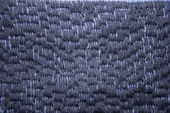 A beautiful pattern of hand made needle point stitch. In gray and blue tones royalty free stock images