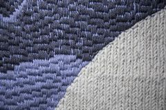 A beautiful pattern of hand made needle point stitch. In gray and blue tones stock image