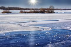 Beautiful pattern on the ice of the river. A Sunny winter day. Frozen river. Beautiful pattern on the ice of the river Stock Photography