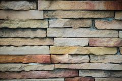 Beautiful pattern of old decorative stone wall background. Vinta Stock Photos