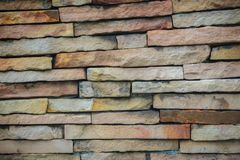 Beautiful pattern of old decorative stone wall background. Vinta Stock Photography