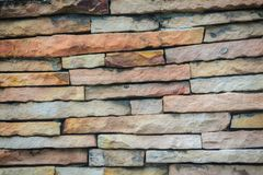 Beautiful pattern of old decorative stone wall background. Vinta Royalty Free Stock Photos