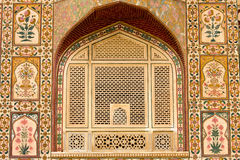 Beautiful pattern on the palace wall, Jaipur, India. Indian ornament on wall of palace in Jaipur fort India Royalty Free Stock Photography