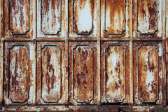 Beautiful pattern on weathered metal wall with rusty texture bac Stock Image
