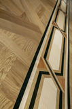 Beautiful patterned parquet from expensive wood Royalty Free Stock Photography